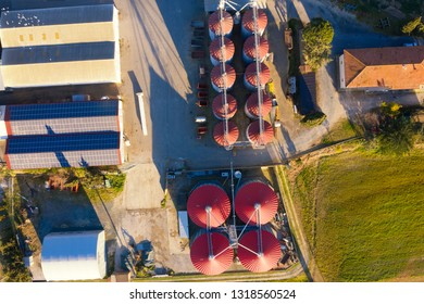 Aerial view of farm with silos