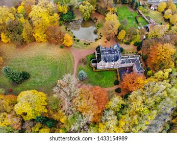 Aerial view of farm style castle surrounded by forest during autumn season, Belgium, Walloon Brabant. 10/18/2018