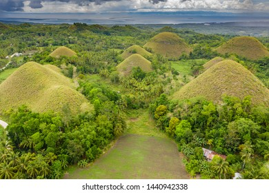 Aerial view of farmland and conical limestone karsts in the unique Chocolate Hills of Bohol, Philippines