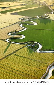 An aerial view of farmland and irrigation canals running throughout the fields.