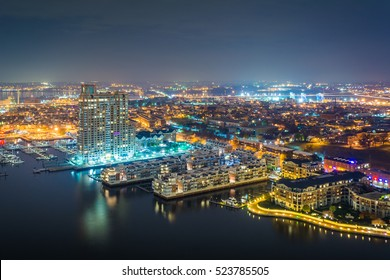 Aerial view of Federal Hill and the Inner Harbor at night, in Baltimore, Maryland.