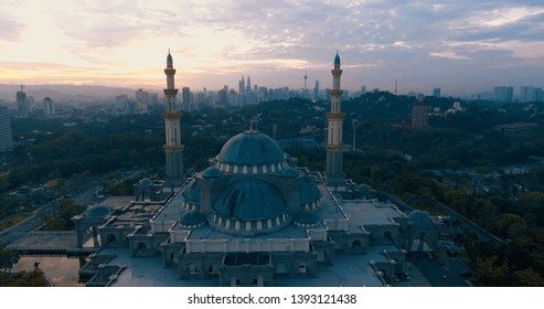 Aerial view of the Federal Territory Mosque, also known as Masjid Wilayah Persekutuan, during daytime in Kuala Lumpur - Malaysia