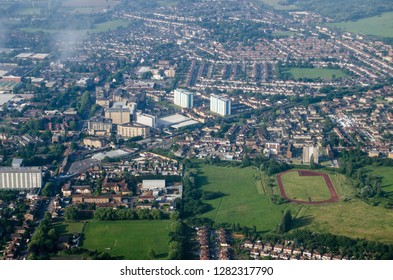 Aerial view of the Feltham district of the London Borough of Hounslow in West London.  A mainly residential area, there are large supermarkets a railway line into central London and playing fields