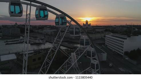 Aerial view of the ferris wheel, Skywheel helsinki, in the city of Helsinki, on a sunny summer evening dusk, in Helsingfors, Uusimaa, Finland