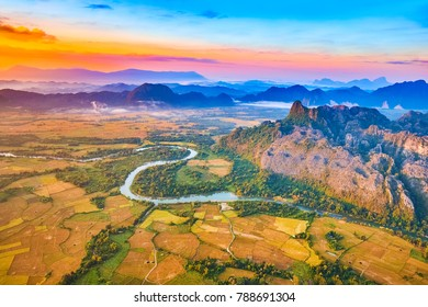 Aerial view of the fields, river and mountain. Beautiful landscape. Vang Vieng. Laos.