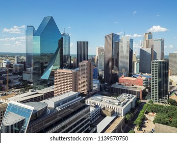 Aerial view financial district in Downtown Dallas, Texas, USA. Modern skyscrapers under summer cloud blue sky. Metropolis and cityscape background
