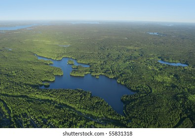 Aerial view of Finnish blue lakes and green forests district