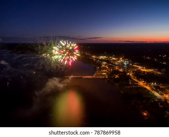 Aerial View Of Fireworks Over Lake At Sunset On Canada Day