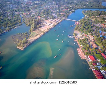 Aerial view of Fisherman jetty at Kelulut beach, Kuala Terengganu, Malaysia during early morning.