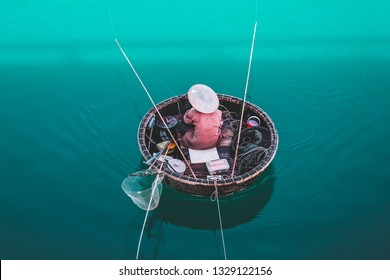 "Aerial view of fisherman on circle boat with straw hat ""Non la"" in Lang Co, Vietnam."