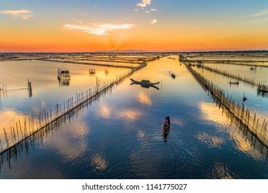 Aerial view of fisherman on Sam lagoon  in Tam Giang lagoon, Hue, Vietnam.