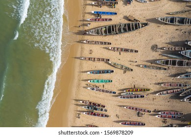 Aerial view of fishing village, pirogues fishing boats in Kayar, Senegal.  Photo made by drone from above. Africa Landscapes.