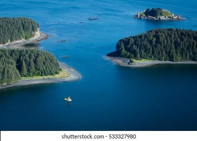 aerial view of float plane taking off in kodiak bay alaska