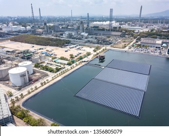 Aerial view of floating Solar Farm or Solar panels on the water in industrial estate.