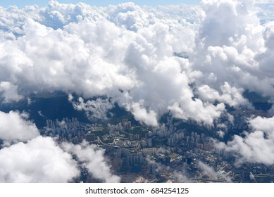 aerial view of fluffy clouds over city