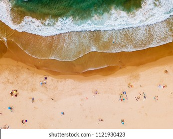 Aerial View From Flying Drone Of People Crowd Relaxing On Algarve Beach In Portugal