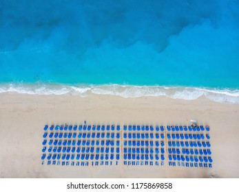 Aerial View From Flying Drone Of People Crowd Relaxing On Beach In Greece.