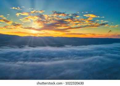 Aerial View. Flying over the clouds . Aerial camera shot. During the sunset. Landscape panorama. - Shutterstock ID 1022320630