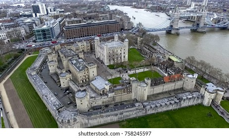 Aerial View Flying Over Tower of London Wall Castle with Tower Bridge and River Thames in England, UK