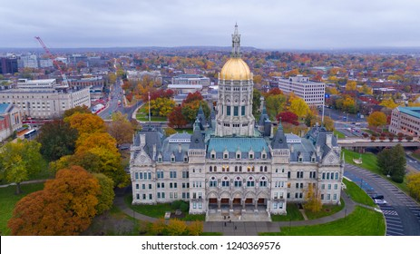 An aerial view focusing on the Connecticut State House with blazing fall color in the trees around Hartford