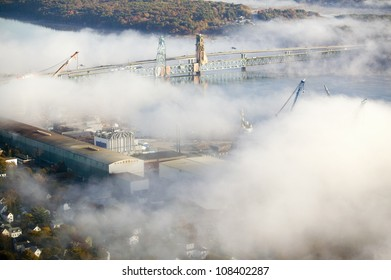 Aerial view of fog over Bath Iron Works and Kennebec River in Maine.