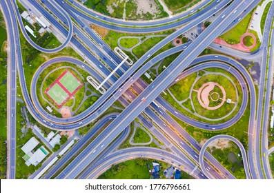 Aerial view footage of car traffic of expressway and intersection in urban. concept or infrastructure and transportation
