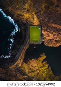 Aerial view of a football field from above near the village Eidi that is now used as a camping site (Faroe Islands, Denmark, Europe)