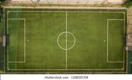 Aerial view of a football pitch shot in midday. Top view of a soccer field.