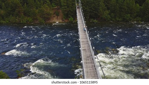 Aerial View of Footbridge over the Rough Niva River in the Kandalaksha Town in Russia