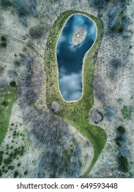 Aerial view of forests and ponds with an idyllic, abstract feel.
