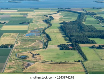 Aerial view of former island Schokland in Flevoland, Holland. The popular archeological site was the first UNESCO World Heritage Site in the Netherlands.It is mainly meadow and farmland.