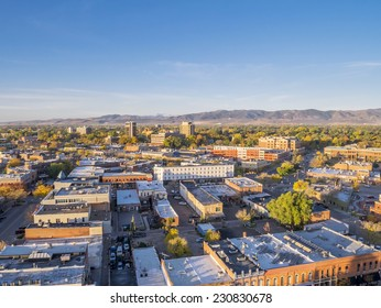 aerial view of Fort Collins downtown in sunrise light, Rocky Mountain foothills in background