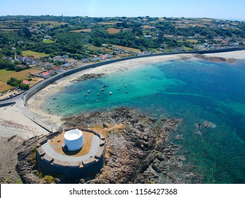 Aerial view Fort grey, built in 1804 to defend the west coast of Guernsey. wonderful beach with white sand and turquoise water and fisher boats