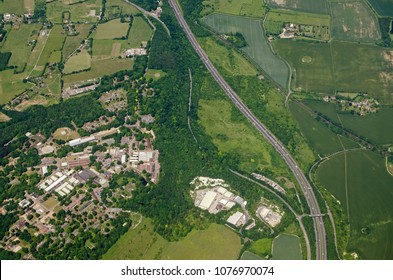 Aerial view of Fort Halstead, home to the Defence Science and Technology Laboroatory of the Ministry of Defence.  Sunny summer day near Sevenoaks, Kent with the M25 motorway.