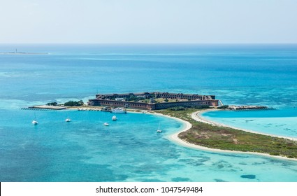 An aerial view of Fort Jefferson located on Garden Key, Dry Tortugas, Florida. In the distance is Dry Tortugas lighthouse located on Loggerhead Key.