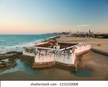 Aerial view of Forte dos Reis Magos (Fort) and skyline of Natal city on background