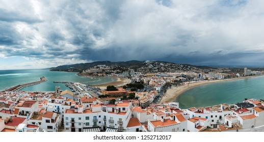 Aerial view of the fortified city and port of Peniscola in the Costa del Azahar in Castellon on a rainy day, Valencian Community in Spain.