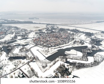 Aerial view of the fortified village Naarden Vesting, Holland, after a snow shower. The town has a star shaped pattern. Star fortifications were developed in the late fifteenth centuries.