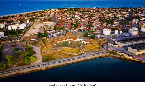 Aerial view of the Fortress of Saint Catarina in Joao Pessoa during golden hour on a warm summer day in Brazil.