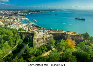Aerial view of fortress Sao Felipe in Setubal Portugal, star shaped military base protecting the city and the harbor with bastions above the turquoise  water of the Atlantic ocean and the Sado estuary