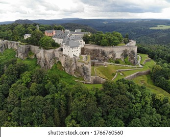 "Aerial view of Königstein Fortress the ""Saxon Bastille"", a hilltop fortress near Dresden, in Saxon Switzerland, Germany, It is one of the largest hilltop fortifications in Europe."