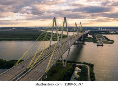 Aerial view of Fred Hartman Suspension Bridge in Baytown, Texas.  View is looking to the south with sun setting in the west.