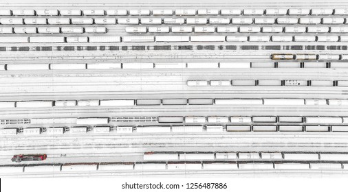 Aerial view of freight train yard covered in snow