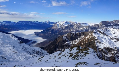 Aerial View of French Alps in France with Beautiful Blue Skies with Clouds and Sunset by Chamonix