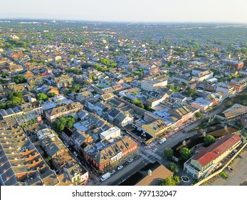 Aerial view French Quarter with extant historical buildings from 19th century. The historic district section of the city of New Orleans, Louisiana, USA, morning warm light.