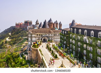 Aerial view of the French village on the top of Ba Na mountain, with beautiful castles, buildings, streets and campuses at the famous tourist destination of Da Nang, Vietnam. Panorama