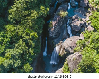 Aerial View of Frog Rock Waterfall - Summer, Waterfall, Valley concept image. Birds eye view use the drone, shot in Jianshi Township, Hsinchu, Taiwan.