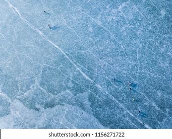 Aerial view of frozen lake. Many ice skaters on the ice. Winter background concept. Dam Ceske Udoli near Pilsen, Czech republic, European union. - Shutterstock ID 1156271722