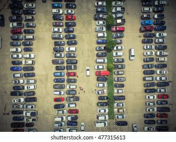 Aerial view full cars at large outdoor parking lots in Houston, Texas, USA. Outlet mall parking congestion and crowded parking lot, other cars try in and out, finding parking space. Vintage filter