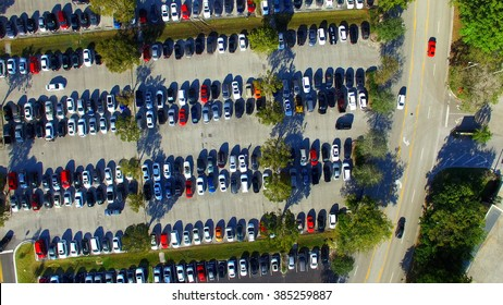 Aerial view of full parking lots.